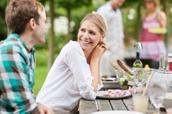 couple flirting with each other at cookout party