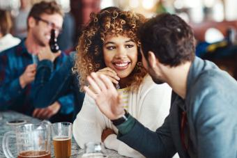 shy woman receiving compliment on date