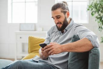 man texting compliment on social media