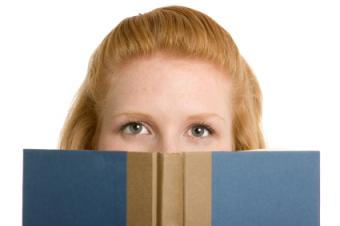woman looking over book