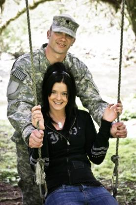 Military man and his wife on swing