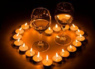 Wine glasses inside a heart of tealight candles