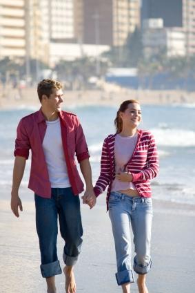 Couple dressed comfortably for a first date on the beach