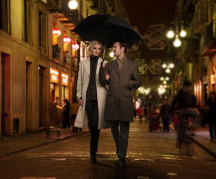 couple walking in the city at night