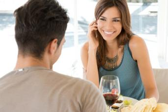Young man and woman drinking wine on a date