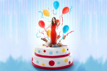 woman jumping out of cake