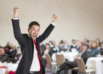 man pumped at conference