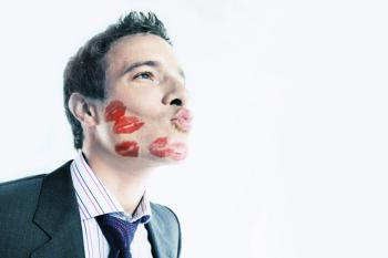 man with kisses all over his face