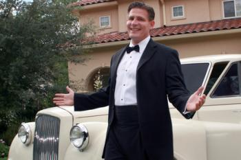 man with limo and tux