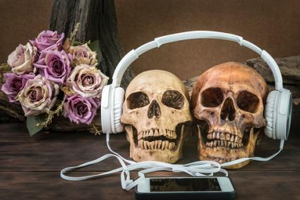 Couple skull listening to music