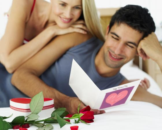 Romantic couple holding card