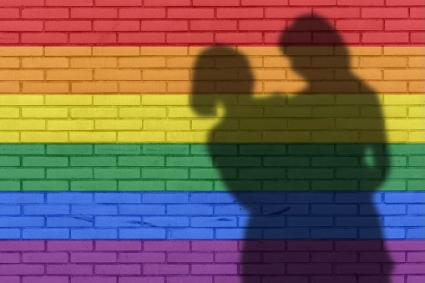 Shadow of couple on rainbow wall