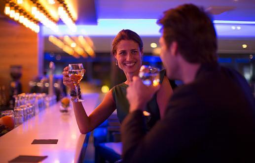 man hitting on woman in bar