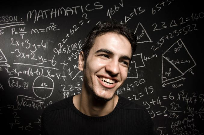 man in front of math equations