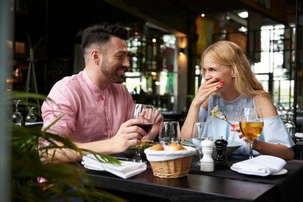 Couple laughing at restaurant table