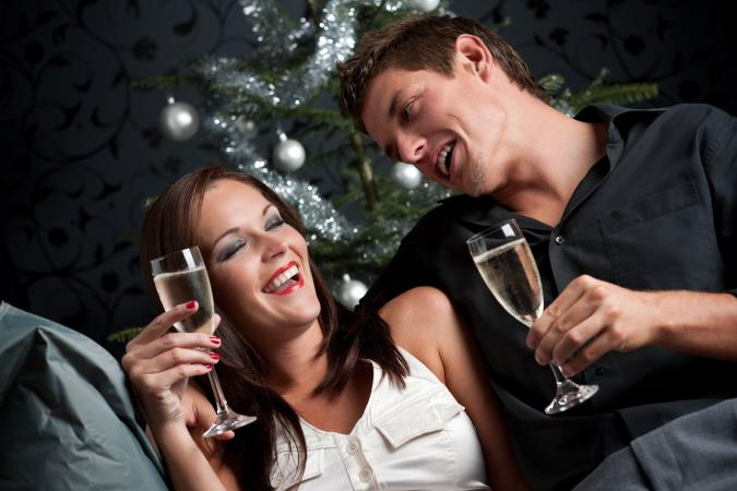 Couple with drinks flirting in bar