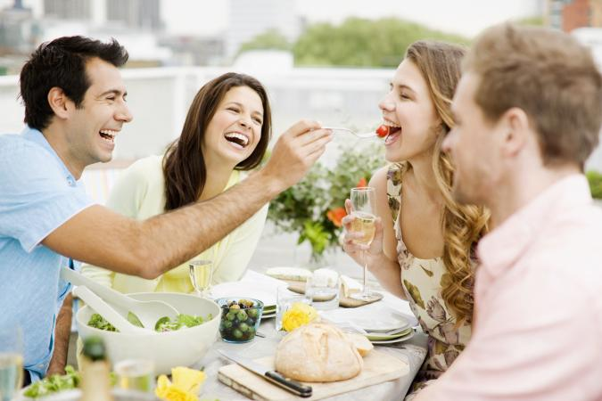 Two couples having lunch smiling