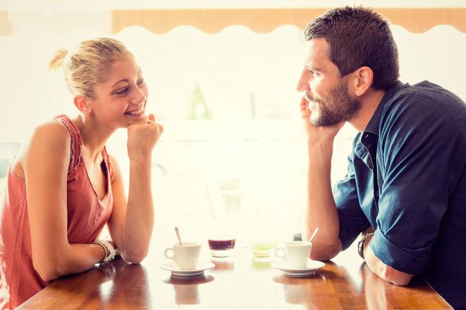 Couple having conversation on date