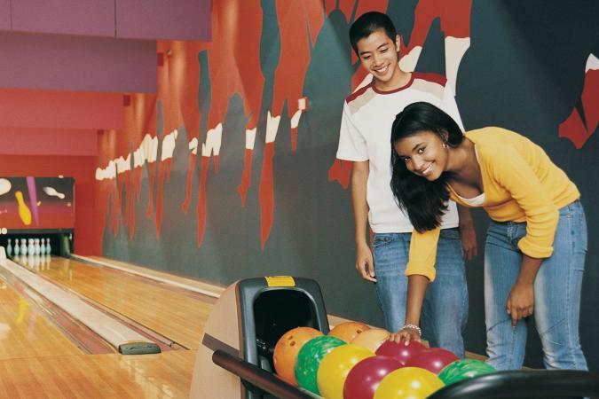 Couple enjoying bowling date