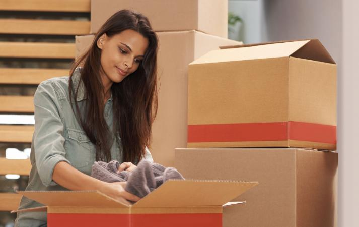 Woman packing ex's belongings in box