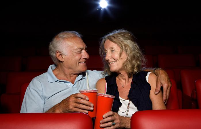 Senior couple in movie theater