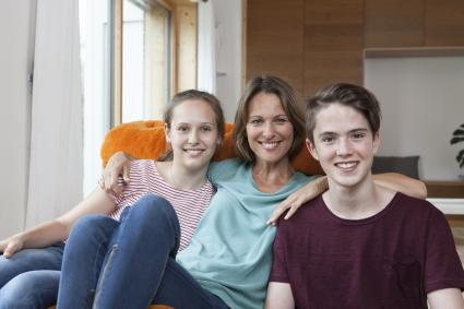 smiling teens with a mom