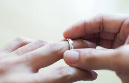 man holding his wedding ring