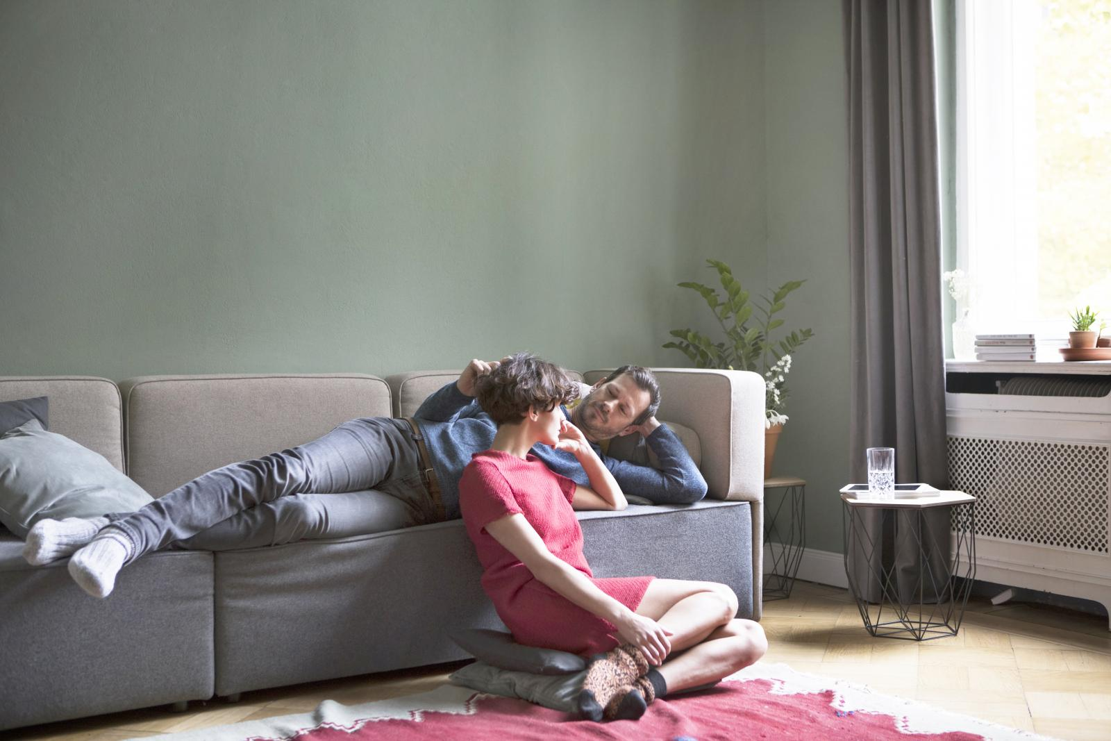 Couple relaxing together in the living room