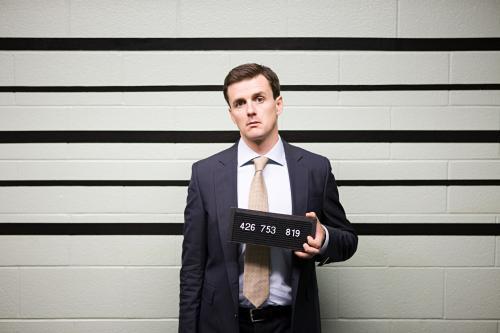 Man in suit mug shot