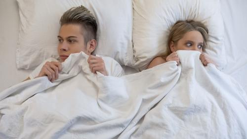 Couple nervous in bed together