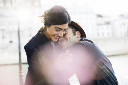 Couple hugging along Seine River