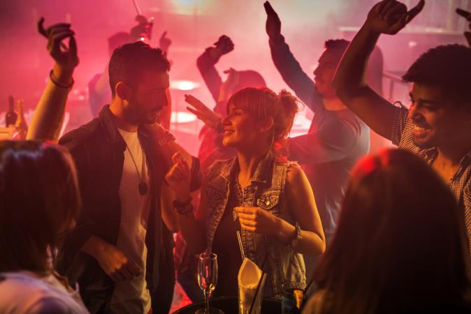 Couple on date and dancing at nightclub