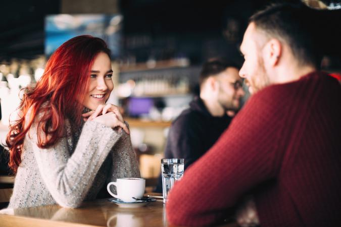 young couple having coffee in restaurant