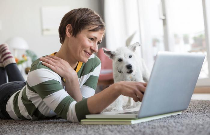 woman lying using laptop