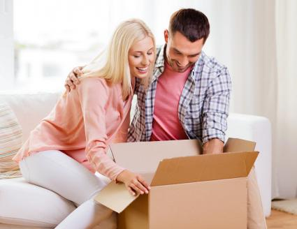 Couple opening box at home