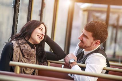 Young guy meets and talks to girl in tram