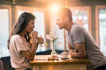 Young couple in love spending time together in a cafe