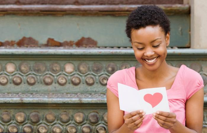woman reading Valentine's Day card