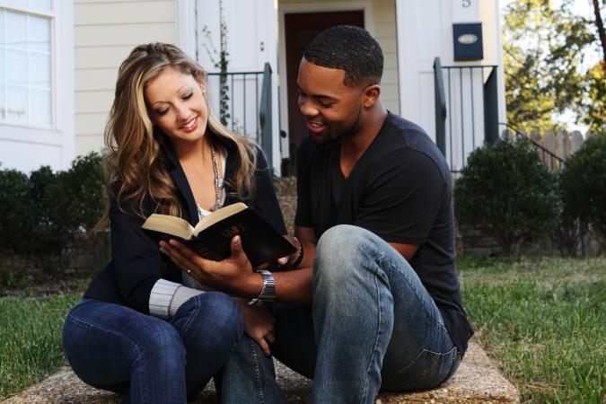 Woman and man reading Bible