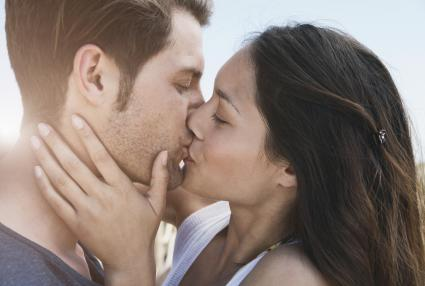 Woman and man kissing