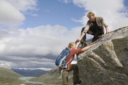 Man and woman enjoying rock climbing