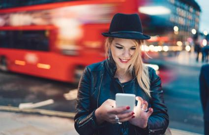 woman text messaging at the street