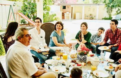 family enjoying breakfast on outdoor patio