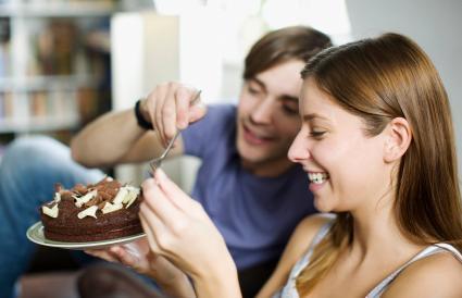 Couple sharing cake