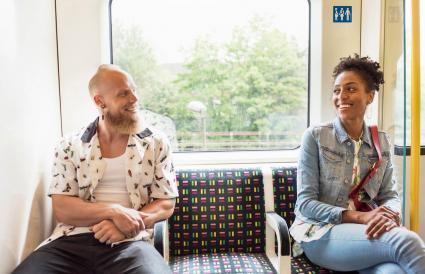 Couple flirting on train