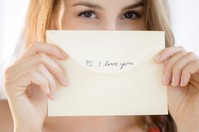 Woman holding a love note