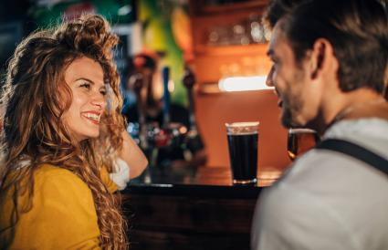 couple drinking beer in pub