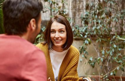 Woman talking at man