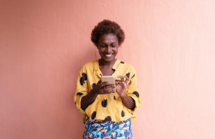 woman smiling on mobile phone