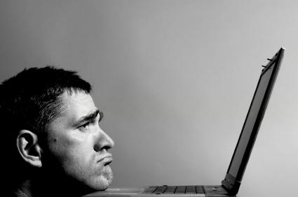 Sad Man at Computer